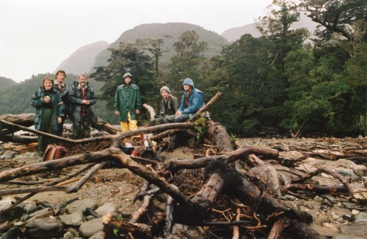 A damp party of botanists emerges from sampling forest on Secretary Island, Fiordland, c.1995. From left - Kath Dickinson, Brent Fagan, Alan Mark, Steven Roxburgh, Brent Kelley, Warren King. Photograph courtesy of the Department of Botany.