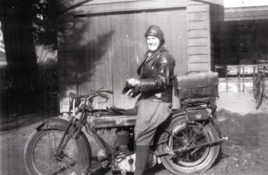 Margaret Foster-Barham on the 1926 Triumph 500cc motorbike she rode from Nelson to Otago. Image courtesy of Judy Hogg.
